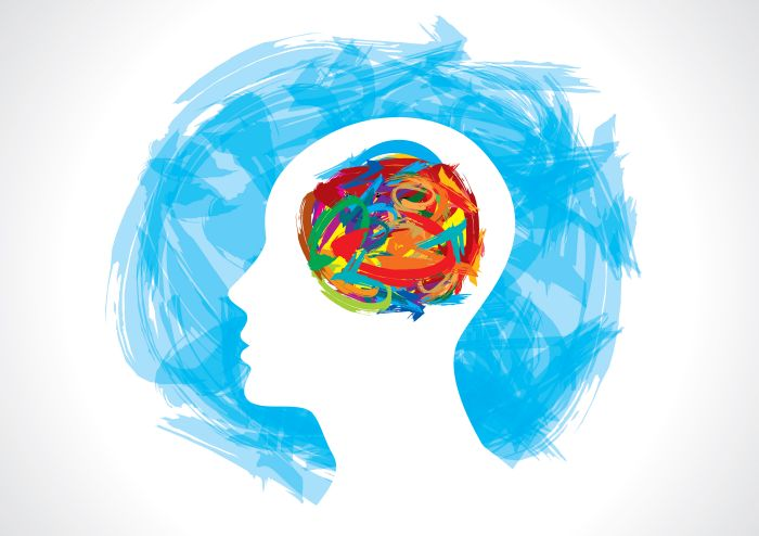 Graphic of colorful brain inside white head silhouette