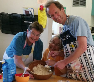 Photo of three people cooking