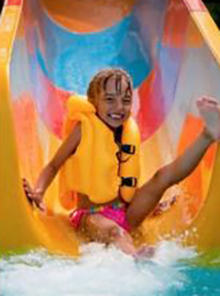 image of child on water slide